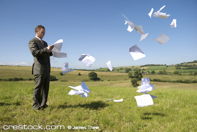 Business concept with paperwork flying everywh...