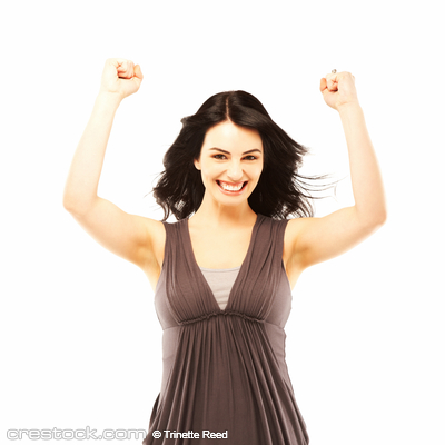 Happy beautiful woman with arms raised in succ...