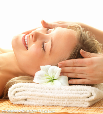 Day spa massaging and relaxation - a happy wom...