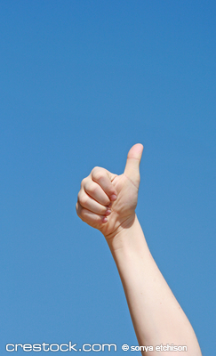 Child Giving a Thumbs Up Against a Clear Blue Sky