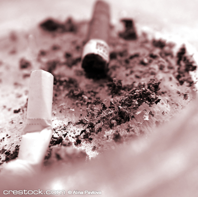 Stubs in an ashtray.rnThe smoking it is harm f...